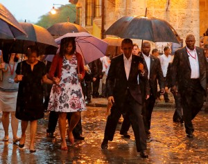 U.S. President Barack Obama steps over a puddle while touring Old Havana with his family, in Havana March 20, 2016. REUTERS/Carlos Barria