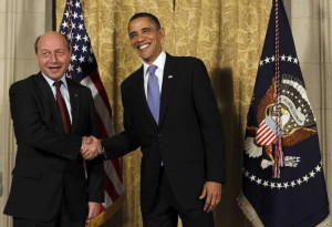 U.S. President Barack Obama greets Romanian President Traian Basescu (L) before a dinner for central European leaders at the U.S. Ambassador's residence in Prague, April 8, 2010. REUTERS/Jason Reed (CZECH REPUBLIC - Tags: POLITICS)
